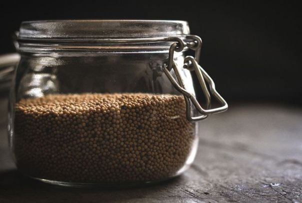 Tiny mustard seeds in a jar